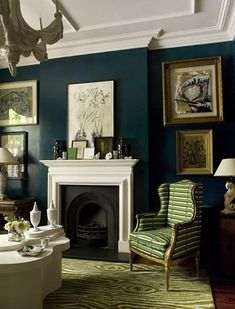Peacock blue walls with white ceiling, molding and trim, black fireplace and a faux bois rug. (Colette van den Thillart's London Home, House & Home Jan 2011 issue, Chris Tubbs photography. Teal Living Rooms, Dark Blue Living Room, Peacock Living Room, Peacock Bedroom, Blue Bedroom, Trendy Bedroom, Dark Green Walls, Teal Walls, Indigo Walls