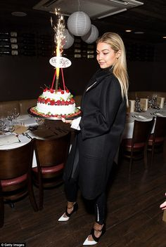Let them eat cake: She posed with a decadent, fruit-covered cake as she celebrated her big...