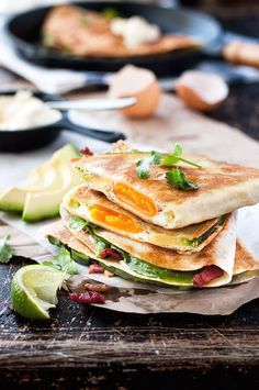 Breakfast quesadillas recipe made with bacon, eggs, avocado and cheddar cheese.