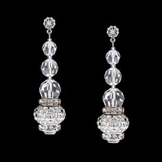 Vintage style and timeless elegance. These graduated drops combine Swarovski® crystals with dazzling charms. long Hypoallergenic surgical steel post Also available in clip-on Non-tarnishing rhodium plate Handmade in USA Simple Earrings, Bead Earrings, Crystal Earrings, Crystal Jewelry, Silver Jewelry, Button Earrings, Diamond Jewelry, Silver Earrings, Crochet Earrings