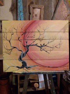 Art on palletwood dead cedar tree and ravens the three sisters and sunset art by Stacie Sheets