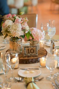 Rustic, but clean centerpiece option that combines raw wood with clear glass and flowers/candles. #rusticweddingcenterpieces