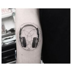 Headphones on Jason; Tattoo by Dr. Woo