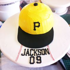 We offer custom cakes, cupcakes, and cake squares in delicious flavors like Pink Lemonade, Red Velvet, Devil's Food and more! Sports Themed Cakes, Devils Food, Bakery Cakes, Specialty Cakes, Pink Lemonade, Custom Cakes, Baseball Cap, Red Velvet, Birthday Cake