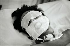 Lynn Johnson's photograph of a comatose bird flu patient in Hanoi (courtesy National Geographic: Women of Vision)