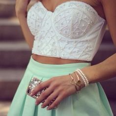Beautiful corseted top and mint skirt. I must find this.