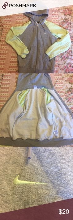 Nike Zip-up Hoodie Full zip sweatshirt in awesome grey with lime green sleeves. SUPER comfy and warm in great condition. Only sign of wear is some inner fleece matting (the normal kind). Nike Tops Sweatshirts & Hoodies