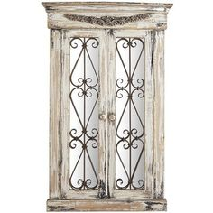 """Named for the French word meaning """"sea village,"""" our handcrafted Merville mirror delivers coastal style to any wall in your <i>chateau</i>. Its rustic fir frame is carved in the style of European casement windows, with an antiqued white stain and cast iron scrolls for added intrigue. A one-of-a-kind focal point for any wall."""