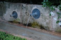 These lead spouts make an excellent water feature and look as though they've been there forever.  You can find similar spouts from the Bulbeck Foundry.  www.bulbeckfoundry.co.uk