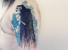 Death among smoke, sketch tattoo. Faus­tine Tar­masz, aka Tarmasz, tattoos curious images onto the skin of her clients. Inspired by mythology and the medieval arts, she translates their pictorial style into body art that, at times, evokes feelings of death and the occult.