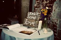 what a great idea. You could use an empty scrapbook that you can later fill with pictures of from the wedding (of those who signed it maybe)    OR a photobook with your engagement photos :)
