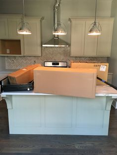 Warm kitchen with limestone chevron backsplash, chrome fixtures and Carrara countertops. Superior Development, Llc. Nashville builder. Design by Jessica Powers.