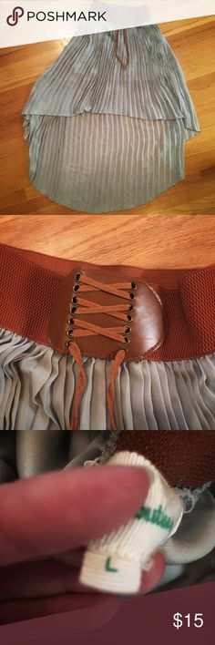 High low skirt with brown waistband Brand new high low skirt, never been worn. Adjustable brown waistband. Front of the skirt's length is 20 inches. Back of the skirt's length is 38 inches.   Always willing to negotiate on prices 🌸 Skirts High Low