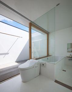 House in Futako-Shinchi by Tato Architects ** Top floor/roof bathroom opening on…