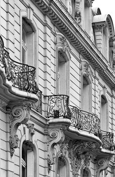Balconies, Paris, France. Classic Haussmann design, love the use of wrought ironwork.