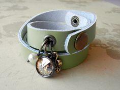 Green Leather Wrap Bracelet with a SWAROVSKI ELEMENTS crystal rivoli stone in a 1-loop rivoli setting, a TierraCast® ivy leaf charm and a freshwater pearl dangle.