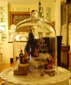 Create a cloche using Christmas village items!