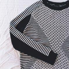 Topshop Monochrome Sweater •Geometric monochrome sweater, high neck silhouette and relaxed feel.  •US6, true to size, would be best for a Medium. 83% cotton, 17% acrylic.  •New with tag. NO TRADES/PAYPAL. Topshop Sweaters Crew & Scoop Necks
