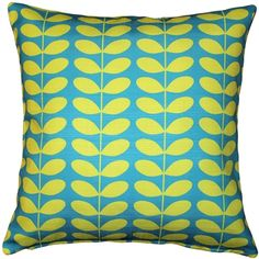 This indoor-outdoor throw pillow features a Danish mid-century modern pattern in lemon yellow on turquoise blue.