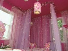 create a canopy reading nook using curtain rods attached to the ceiling to allow for closing and opening; put a fuzzy rug on the floor along with some pink girly pillows for lounging