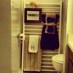 Repurposing a crib - GENIUS... Great idea for bathroom!!