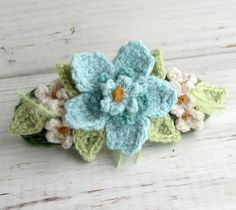 This hair barrette is made on a grass green cotton and wool base with flowers in cashmere in the colors of light pink, dark pink, melon (has a touch of . Crochet Hair Barrette Pink with Blue Flowers Crochet Brooch, Crochet Bracelet, Crochet Motif, Cute Crochet, Knit Crochet, Crochet Earrings, Beautiful Crochet, Beaded Bracelet, Crochet Hair Accessories