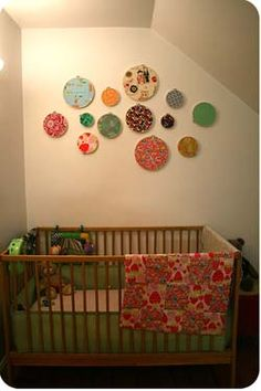 Love this idea for decorating the wall above the crib for the nursery for the new baby....Embroidery Fabric Hoops with pieces of colorful coordinating fabric in them hand in any configuration you like!
