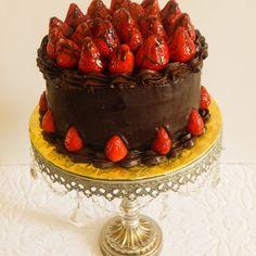 Dark chocolate Strawberries Cake An amazing 4 layered chocolate sponge cake…