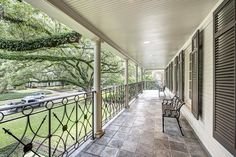 2240 Chilton Houston, TX 77019: Photo Charming second floor balcony overlooking the front yard with beautiful views of the mature oak trees.