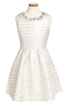 Free shipping and returns on Trixxi Shimmer Dot Jacquard Fit & Flare Party Dress (Big Girls) at Nordstrom.com. Shimmerymetallic dots catch the light on a sleeveless fit-and-flare party dress detailed with dazzling silver sequins and pearly beads at the banded neckline.