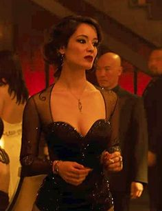 Bérénice Marlohe as Severine in Skyfall, sparkling in an alluring black satin dress embellished with bespoke crystal tattoos featuring 60,000 Swarovski Elements