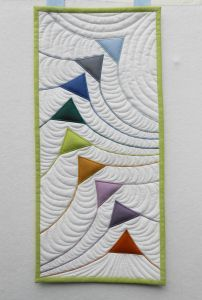 Flying Triangles - Sheena J Norquay These are appliqued on - great place to practice machine quilting Sheena Norquay's Scottish Highlands Collections were inspired by the colours of mountains, forests, moorlands, and lochs of the Scottish Highlands as w Colchas Quilting, Free Motion Quilting, Machine Quilting, Quilting Projects, Crazy Quilting, Small Quilts, Mini Quilts, Patchwork Vol D'oie, Flying Geese Quilt