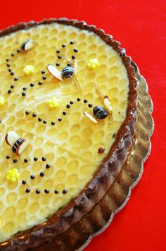 """Oh, honey! We're all abuzz over our Honey Lemon Tart, featuring a white chocolate lemon layer, housemade """"honeycomb"""" and a buttery chocolate crust. Now if you'll excuse us while we keel over from cuteness! #honey #lemon #tart #honeycomb"""