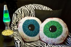 Crocheted eyeball pillow.  Perfect pattern for teens and Halloween decorating.