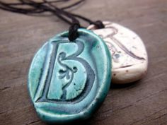Love the glazes on these. Monogram essential oil diffuser necklace made with lead free glazes. $11.95 from This One's Mine Ceramic Design