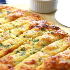 Homemade Garlic Cheese Breadsticks Recipe – If you go to your local pizzeria and order the garlic cheese breadsticks, then you will adore making these even better (way better) at home! recipes no yeast videos Homemade Garlic Cheese Breadsticks Cheese Recipes, Appetizer Recipes, Dinner Recipes, Chicken Recipes, Tasty Breakfast Recipes, Party Food Recipes, Fast Breakfast Ideas, Superbowl Party Food Ideas, Seafood Appetizers