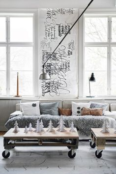 Makes me miss my Prague flat. Love the art between the windows. The grey and white. The pallets on wheels. The lamps. Everything.
