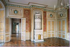 Gustavian Style | Tullgarn Palace, crystal chandelier, tiled fireplace, wood floor. | Photo by Michael Perlmutter.