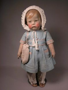 "Kathe Kruse doll number one (17""), in antique clothing and having no repaint or touch up to head."
