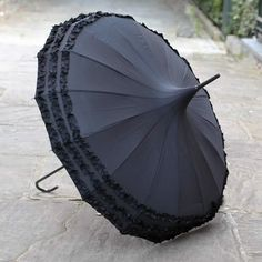 Gorgeous pagoda umbrella black, a Lindy Lou umbrella design, beautifully elegant pagoda shape and available to buy online from our Spitalfields UK shop
