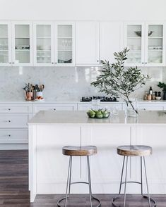 Tractor stools from Freedom sit under the island bench, which features a Talostone Carrara Gioia benchtop. Kitchen cabinetry is by Stuart Peart of Castlereagh Cabinets*Photography: Abbie Melle*