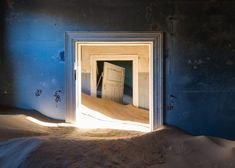 les sables du temps_ghost town engulfed by mounds of sand by romain veillon, kolmanskop