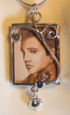 Stained glass pendant…silver soldered glass with silver scroll accents. Print of my original artwork of  Elvis. Silver chain. $30