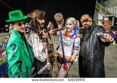 Sheffield, UK - June 12, 2016: Cosplayers dressed as 'The Riddler', 'Captain Jack Sparrow', 'Harley Quinn' and 'Nick Fury' at the Yorkshire Cosplay Convention at Sheffield Arena