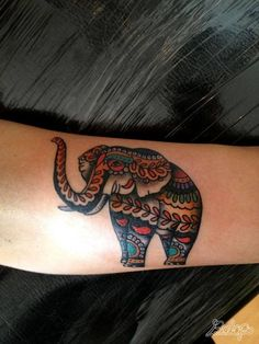 american traditional elephant tattoo | An elephant is decorated with paisley patterns in this decorative ...