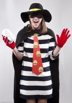 Hamburglar - Key Elements:      Striped Dress     Black Cape     Black Hat with Yellow Band     Robber's Mask     Hamburger Necktie     Red Gloves...