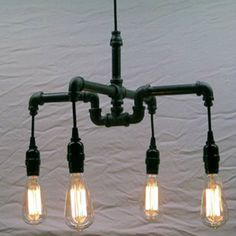 Industrial - Steampunk Black Malleable Iron Chandelier Milton Douglas Lamp Co. An industrial-chic malleable iron chandelie… Pipe Lighting, Rustic Lighting, Vintage Lighting, Cool Lighting, Chandelier Lighting, Lighting Ideas, Pendant Lights, Industrial Chandelier, Industrial Pipe
