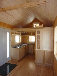 tiny home, tiny house interior. This tiny home was made by Vastu Cabin in Iowa. Would love this for a reading/writing place.