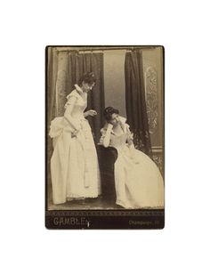 vintage cabinet card: woman sneaking up on herself