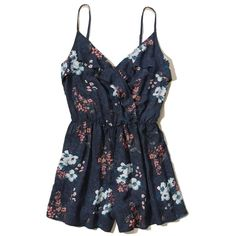 Hollister Wrap Front Ruffle Romper ($30) ❤ liked on Polyvore featuring jumpsuits, rompers, dresses, hollister, navy floral, playsuit romper, navy romper, wrap romper, flounce romper and floral romper